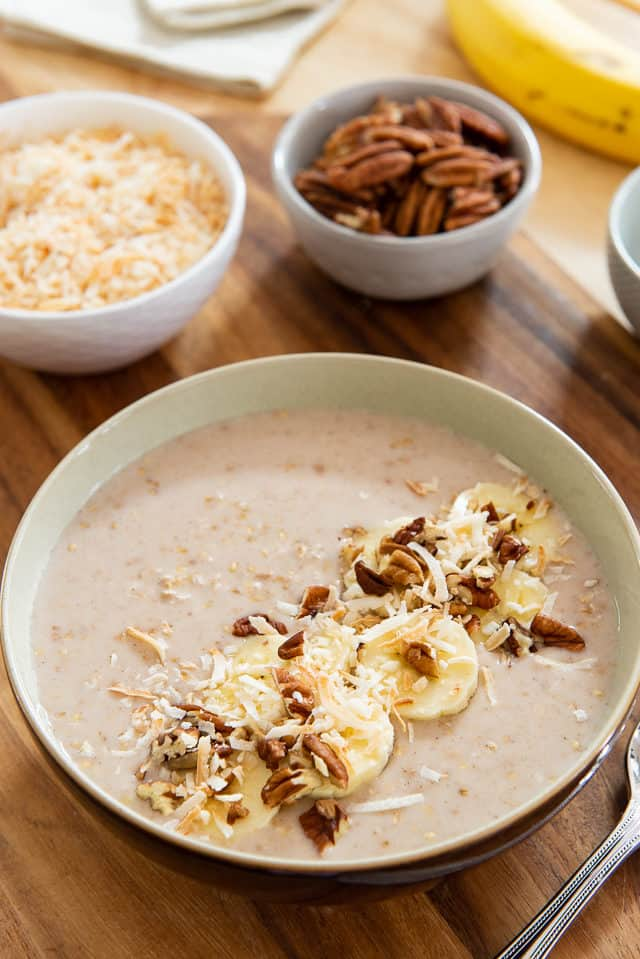Overnight Steel Cut Oats - In a bowl with Slices of Banana and Pecans