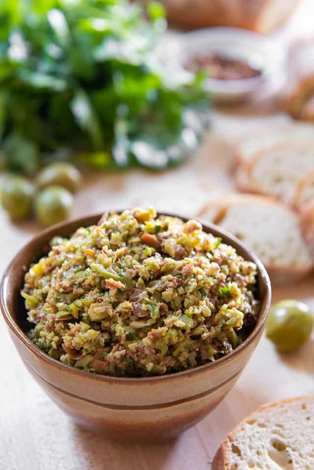 Tapenade - In a Brown Bowl with Bread Slices and Olives