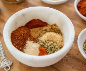 Fajita Seasoning Recipe - Served in a White Bowl on Wooden Board
