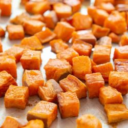 Oven Roasted Sweet Potatoes On Sheet Pan in Cubes