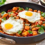 Sweet Potato Hash In a Skillet with Fried Eggs On Top