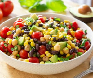 Avocado Bean Salad In White Bowl with Corn and Tomatoes
