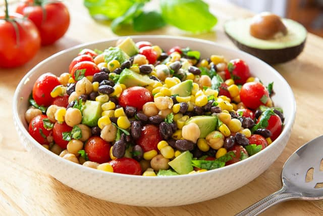 Avocado Bean Salad Recipe -  Served in White bowl With Grape Tomatoes, Chickpeas, and a Simple Dressing