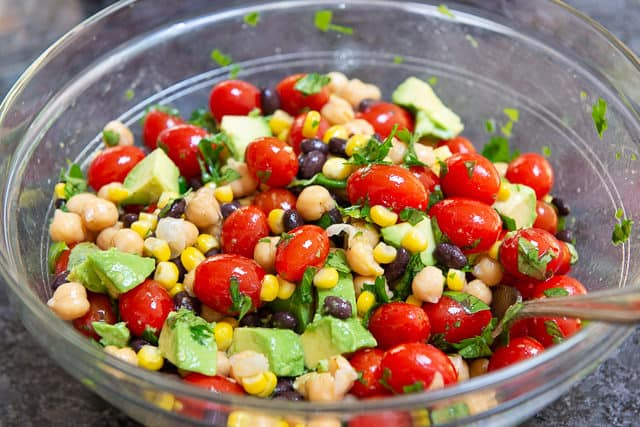 Black Bean Chickpea and Avocado Salad - in Glass Bowl Mixed Together
