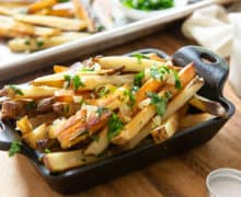 Garlic Fries In cast Iron Dish with Garlic and Parsley
