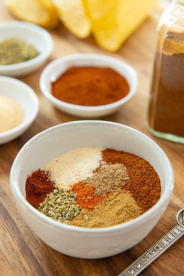 Taco Seasoning - in gray bowl with Paprika, Garlic Powder, Oregano