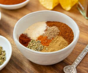 Beef Taco Seasoning in White Bowl on Wooden Board