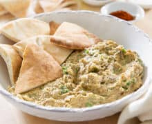 Baba Ganoush Served in a White Bowl with Pita Wedges