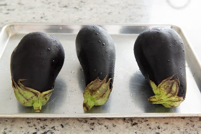 Three Eggplants on a Sheet Pan