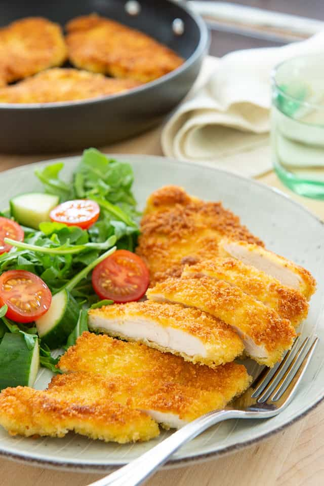 Chicken Milanese - Sliced and Served on Plate with Salad