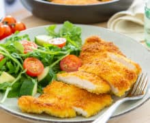 Chicken Milanese Sliced and Served on Plate with Salad