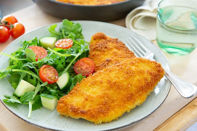 Chicken Milanese Recipe - Plated on Blue Plate with Salad