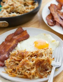 Hash Browns - On a Plate With Egg and Oven Bacon