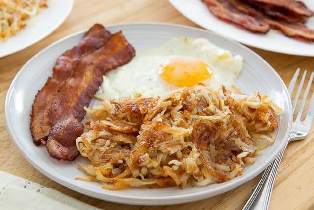 Hash Brown Recipe - Plated on Gray Dish with Fried Egg and Bacon