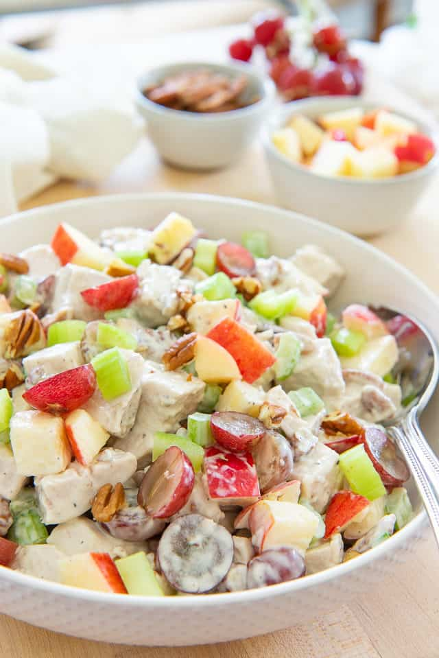 Waldorf Chicken Salad - In a White Bowl With Grapes, Pecans, Apples, Celery, and a Mayonnaise Dressing