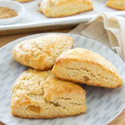 Ginger Scones with Crystallized Ginger Pieces and Cream on a Grey Plate