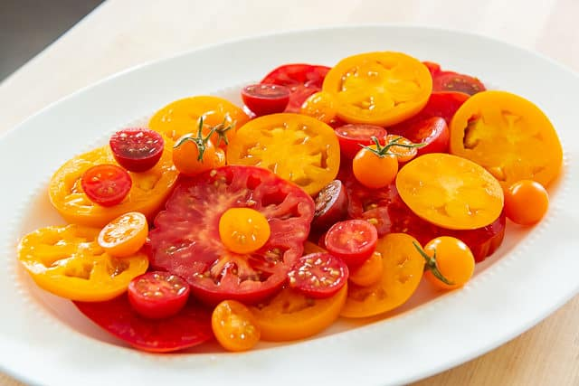 Heirloom Tomatoes - Red and Orange, Sliced on a Big Platter