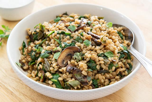 Pearl Barley With Baby Bella Mushrooms, Basil, Oregano, and Thyme in White Bowl