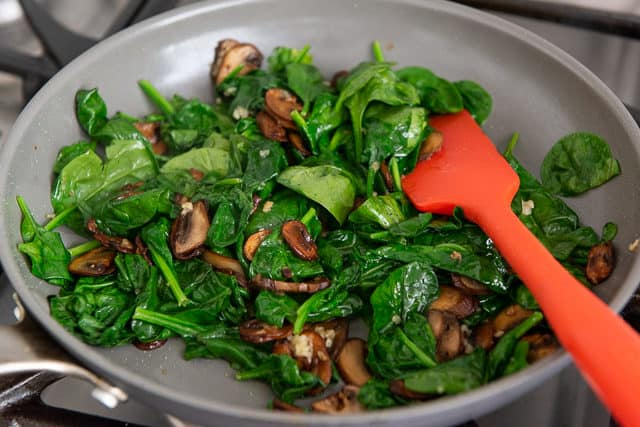 Wilted Spinach, Mushrooms, and Garlic in Skillet