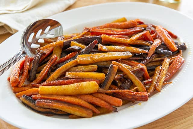 Roasted Rainbow Carrots - On a White Platter With Spices and Olive Oil