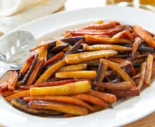 Roasted Carrots Served on White Platter with Spoon