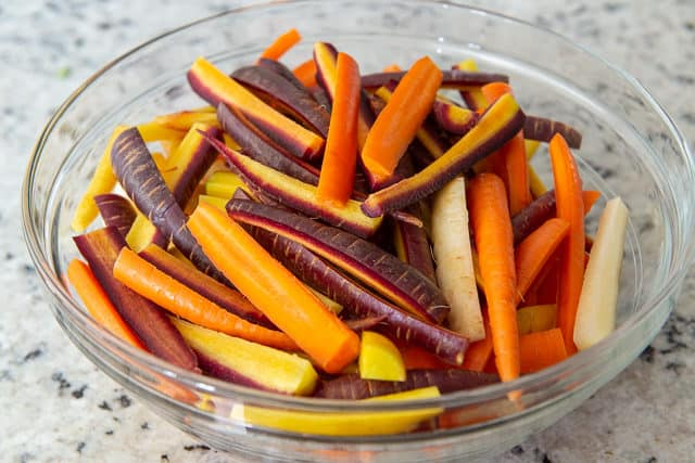 Cut Carrots in Sticks in Bowl Ready to Cook in the Oven