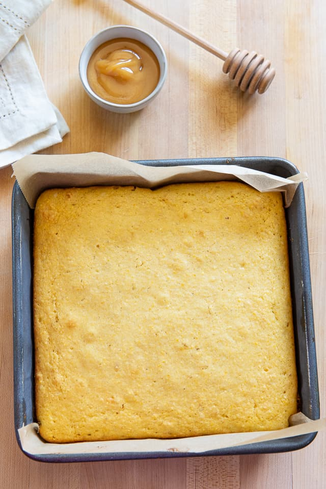 Cornbread - An 8x8 pan with honey and honey spreader