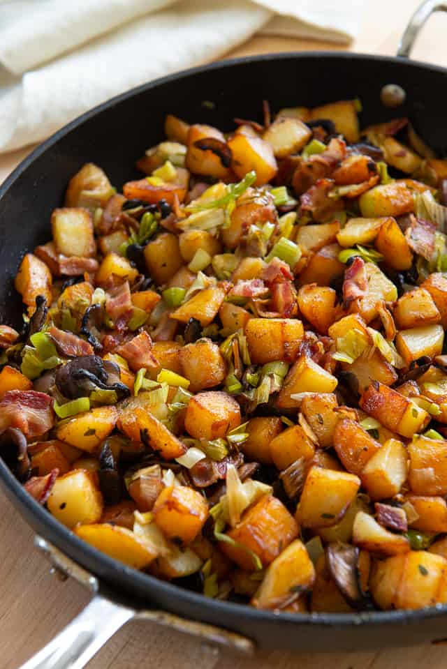 Potato Hash - In a Black Skillet with Leeks, Bacon, and Mushrooms