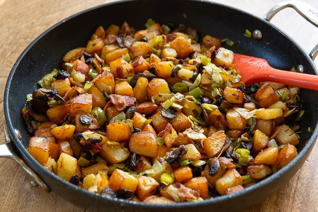 Potato Hash Recipe - Served in a Black Nonstick Skillet with Red Spatula