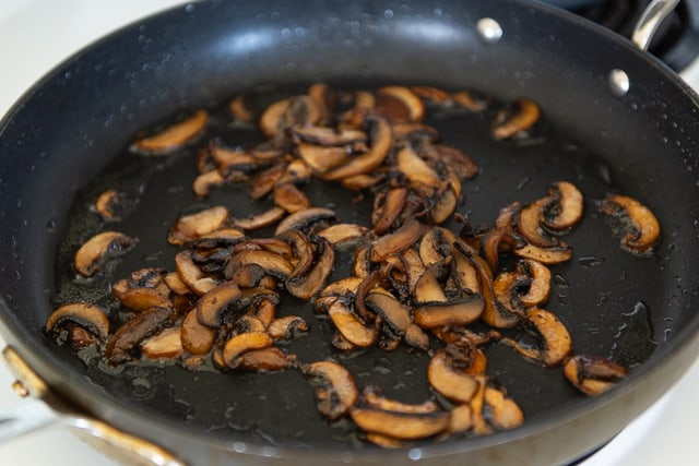 Sliced Baby Bella Mushrooms Cooked in Bacon Fat until Browned