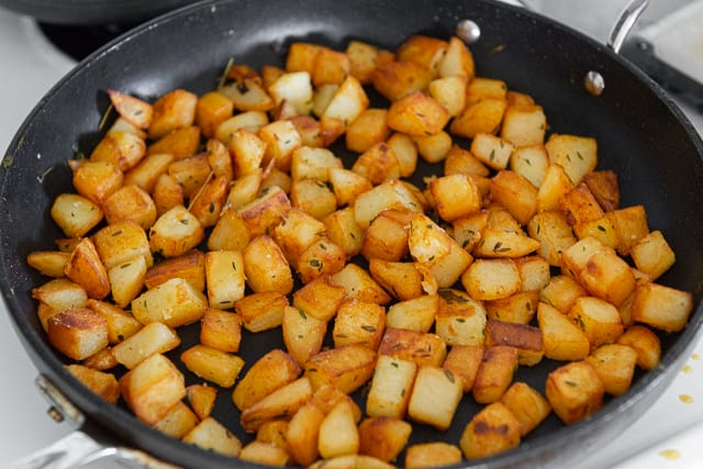 Golden Brown Russet Potato Chunks Cooked in Skillet