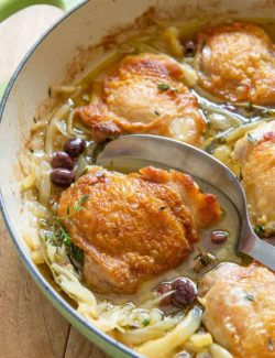 Braised Chicken Thighs With Metal Spoon in Green Braiser