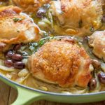 Braised Chicken Thighs Recipe - Served in light Green Braiser with Olives and Fennel