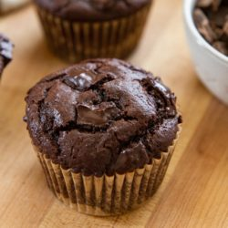Chocolate Chunk Muffin on a Wooden Board