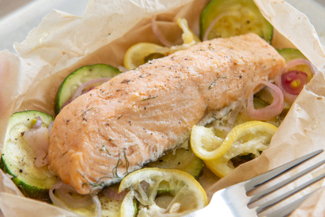 Salmon En Papillote Recipe - Presented on a Sheet Pan with Fork Alongside