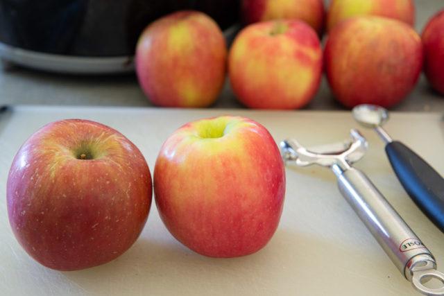 Fuji Apple and Pink Lady Apple on Cutting Board with Peeler
