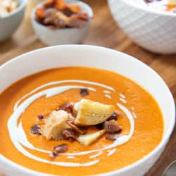 Tomato Bisque in White Bowl with Croutons and Bacon