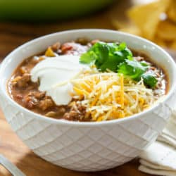 Ground Turkey Chili in Bowl with Sour Cream and Beans