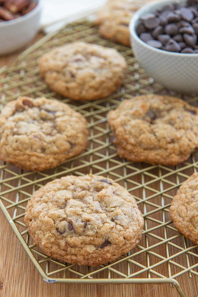 Chewy Oatmeal Chocolate Chip Cookies - on a Wire Rack on a Wooden Board