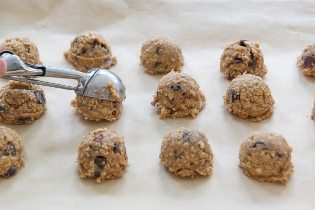 Portioning Scoops of Oatmeal Chocolate Chip Cookie Dough onto Parchment Paper