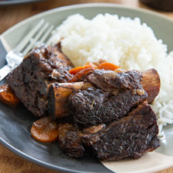 Slow Cooker Beef Short Ribs On a Plate with White Rice and a Fork