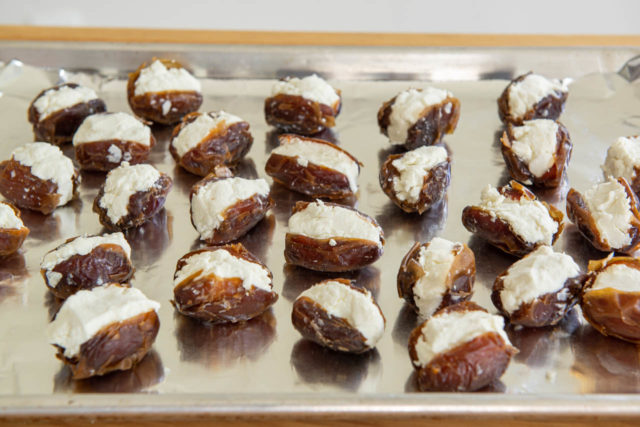 Goat Cheese Stuffed Dates on Foil on Sheet Pan