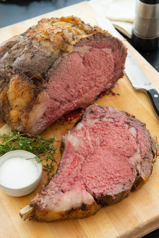 Prime Rib - Sliced and Standing on a Wooden Board