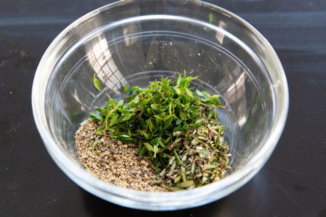 Black Pepper, Chopped Rosemary, and Chopped Thyme in a Glass Bowl