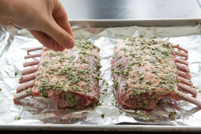 Sprinkling Salt Onto Rack of Lamb