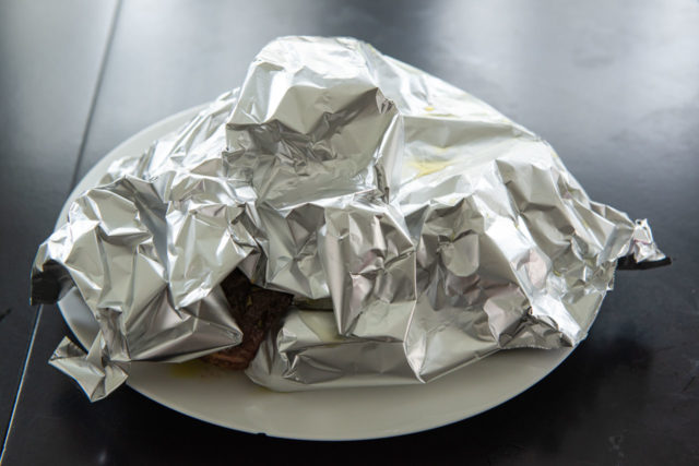 Foil Tented Over the Meat on a White Plate