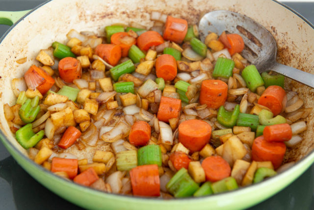 Cooked Carrot, Celery, Onion, and Parsnip in Pan with Beef Drippings