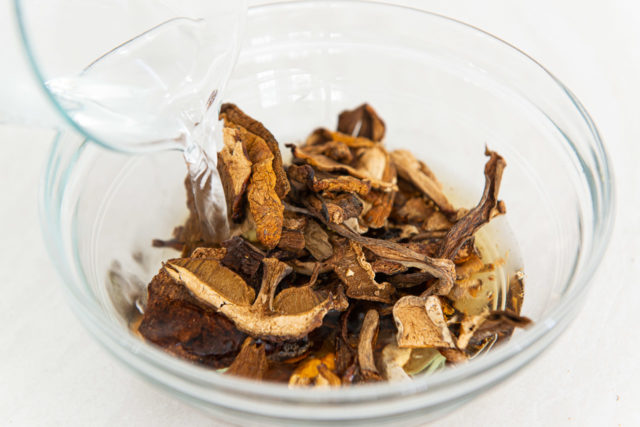 Dried Porcini Mushrooms in Glass Bowl with Water