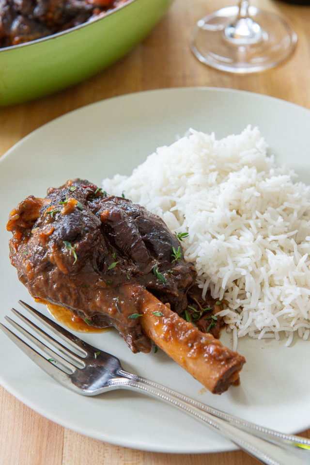 Braised Lamb Shanks - Plated with White Rice and Fresh Thyme