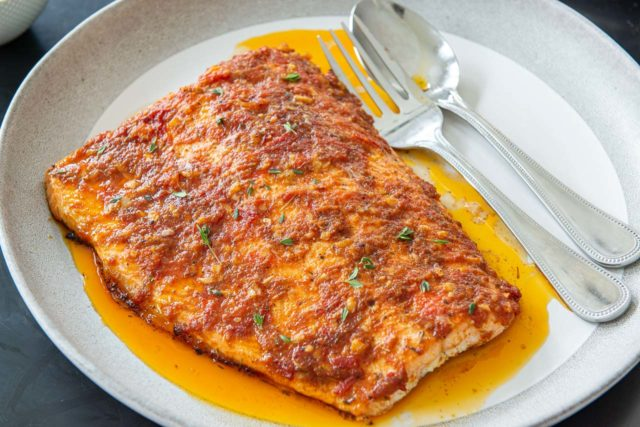 Cajun Salmon Recipe - Plated on a Gray and White Dish with Fork and Spoon